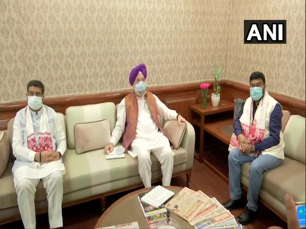Minister of Petroleum and Natural Gas Hardeep Singh Puri with Minister Dharmendra Pradhan and MoS Rameswar Teli  (photo/ANI)