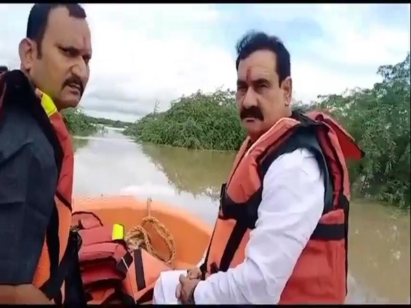 MP Home Minister Narottam Mishra after being rescued from the flood-affected village. (Photos/ANI)