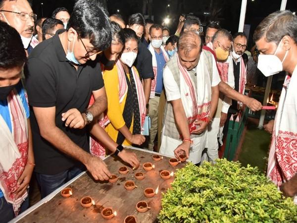 Assam CM Himanta Biswa Sarma lighting an earthern lamp for boxer Lovlina Borgohain (Photo/ANI)