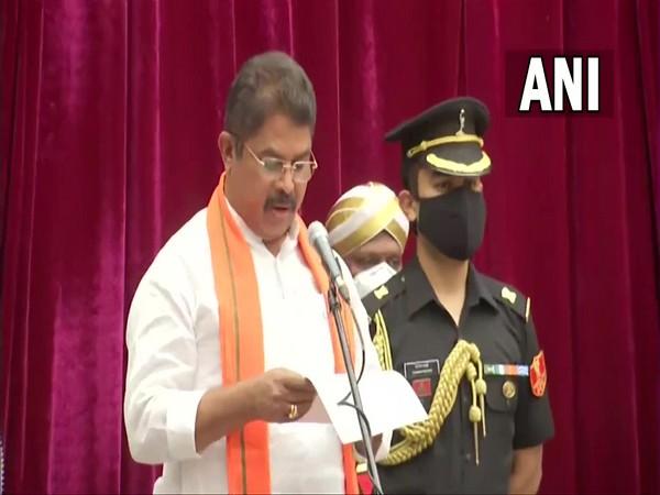 R Ashok taking oath as a minister in the new Karnataka Cabinet at Raj Bhavan in Bengaluru on Weednesday. [Photo/ANI]