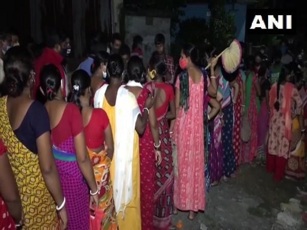 Women waiting outside Niranjan Nagar Covid vaccine centre (Photo/ANI)