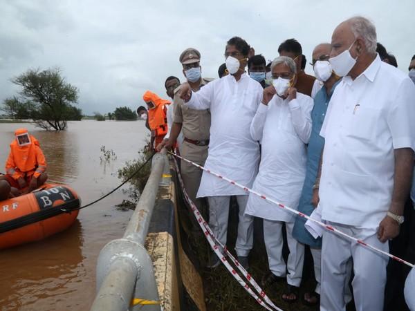 Karnataka Chief Minister BS Yediyurappa at the Hiranyakeshi River in Belgaum . (Photo: Twitter @BSYBJP)