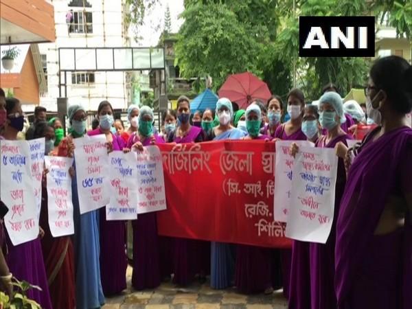 ASHA workers protest in Siliguri on Tuesday. [Photo/ANI]