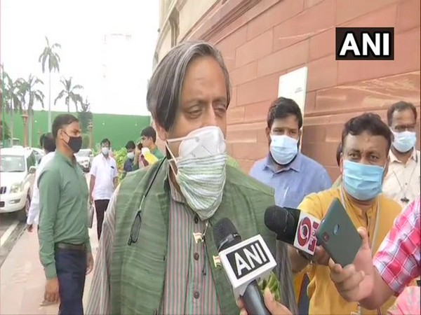 Congress MP Shashi Tharoor speaking to reporters at Parliament in Delhi on Thursday. [Photo/ANI]
