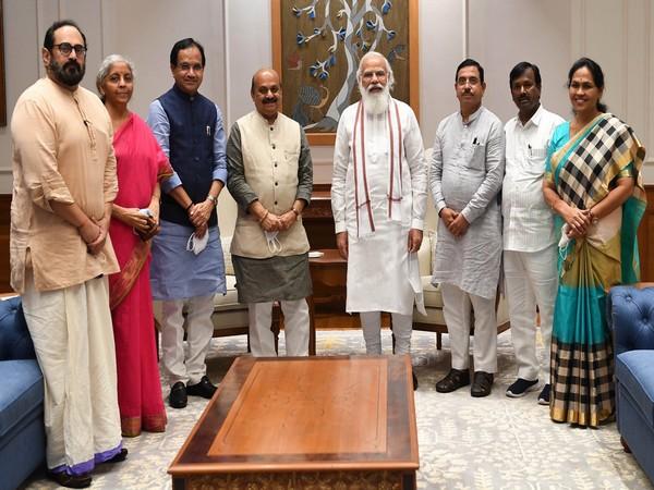 Karnataka CM Basavaraj Bommai with Prime Minister Narendra Modi and Central Ministers
