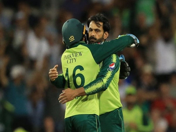 Hafeez and Rizwan celebrate fall of a wicket (Photo/ ICC Twitter)