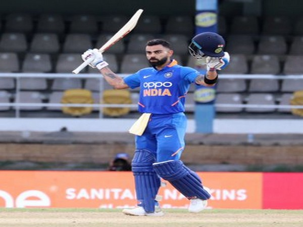 Indian skipper Virat Kohli raises his bat after scoring a century against West Indies in third ODI. (Photo/BCCI Twitter)
