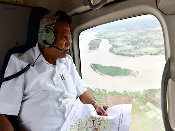 Chief Minister BS Yediyurappa conducting aerial survey of flood-affected areas in Karnataka on Monday. Photo/ANI