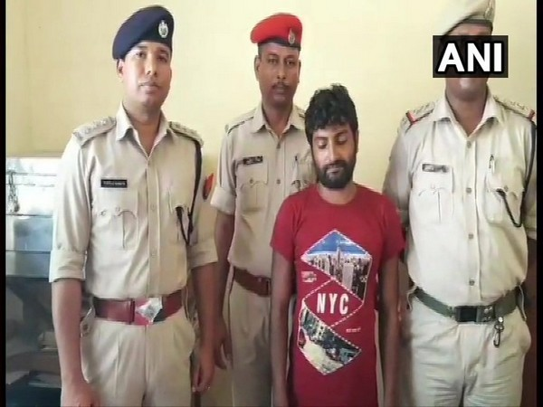 Visuals of the accused (red t-shirt) with police in Assam.