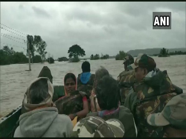 Army rescuing people in flooded-affected areas of Karnataka on Thursday.