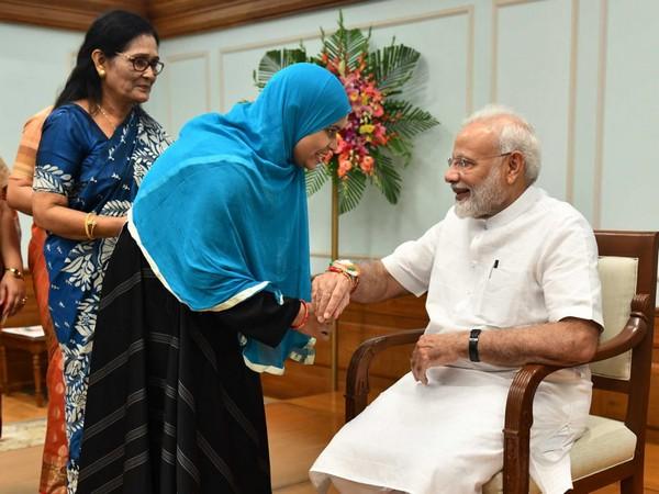 Ishrat Jahan tying Rakhi on Narendra Modi's wrist.