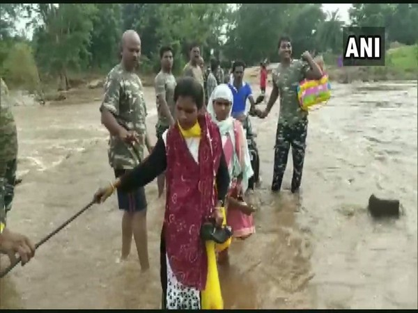 CRPF personnel formed a human chain to help the locals cross a bridge. Photo/ANI
