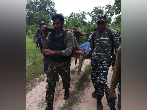 CRPF personnel carried a man bitten by snake on their shoulders for around 2.5 kms. Photo/ANI