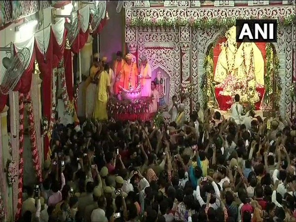 Devotees celebrating Janmashtami at Shri Krishna Janmabhoomi Temple in Mathura, UP.