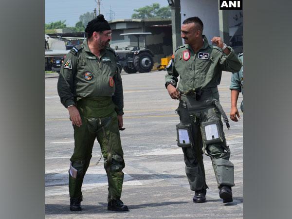 IAF Chief BS Dhanoa with Wing Commander Abhinandan Varthaman.
