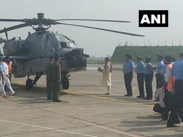 IAF Chief BS Dhanoa and Western Air Commander Air Marshal R Nambiar near the Apache choppers for 'Pooja' ceremony before induction. Photo/ANI
