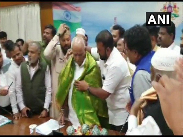 Karnataka Chief Minister BS Yediyurappa meets minority leaders in his office on Wednesday. Photo/ANI