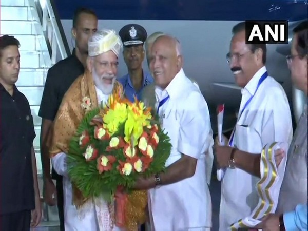 Prime Minister Narendra Modi was received by Chief Minister BS Yediyurappa in Bengaluru on Friday.