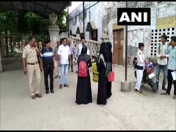 Firozabad:Some students were denied entry to SRK College,allegedly because they were wearing burqa. Photo/ANI