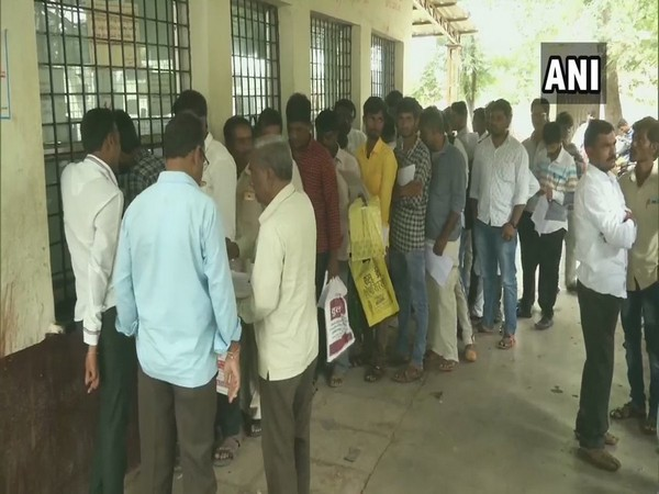 Locals queue up at the RTO office in Kalaburagi on Friday (Photo/ANI)