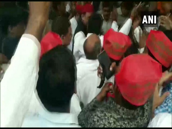 Chaos in PWD guest house as workers jostled to meet SP chief Akhilesh Yadav on Sunday. Photo/ANI