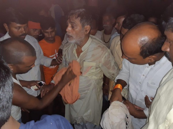 BJP MP Kripal Yadav being rescued by locals after he fell in flood-water in Patna. Photo/ANI