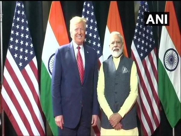 US President Donald Trump (L) and Prime Minister Narendra Modi (R) in Houston on Sunday (Photo/ANI)