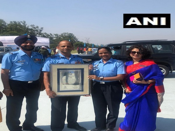 Squadron Leader Minty Agarwal with her commanding officer Group Captain Abhijit Nene after their 601 Signal Unit was awarded unit citation by IAF Chief. Photo/ANI