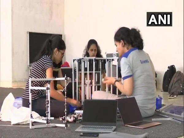 The girls are building a robot that can pick up pollutants from the ground and put it on a higher level. Photo/ANI