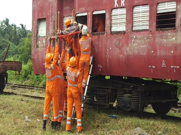 NDRF and KRCl are demonstrating the rescue activity by cutting window of the coach in the mock exercise at Verna Goods Yard in Goa today. Photo/ANI