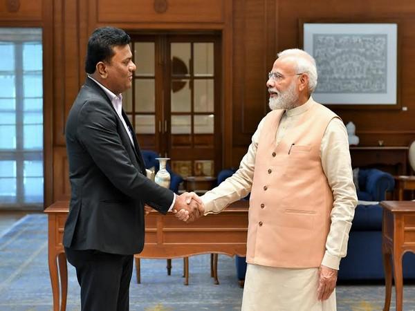 Prime Minister Narendra Modi with Captain Amol Yadav in New Delhi on Sunday.