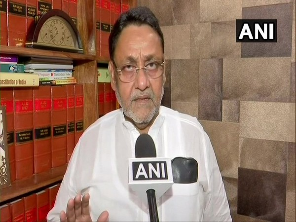 NCP leader Nawab Malik speaking to ANI on Sunday. Photo/ANI