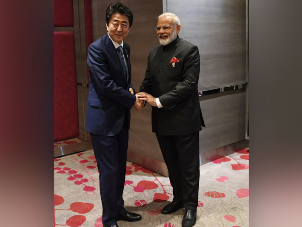 PM Modi along with his Japanese counterpart Shinzo Abe in Bangkok on Monday. Photo/Twitter