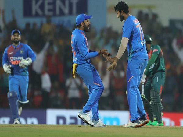 Rohit Sharma and Shivam Dube celebrate the dismissal of Mohammad Naim (Photo/ BCCI Twitter)