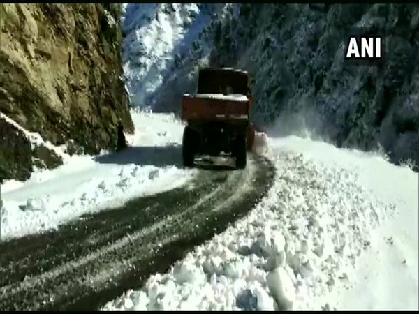 Snow clearing operations taking place at the Mughal road on Monday.