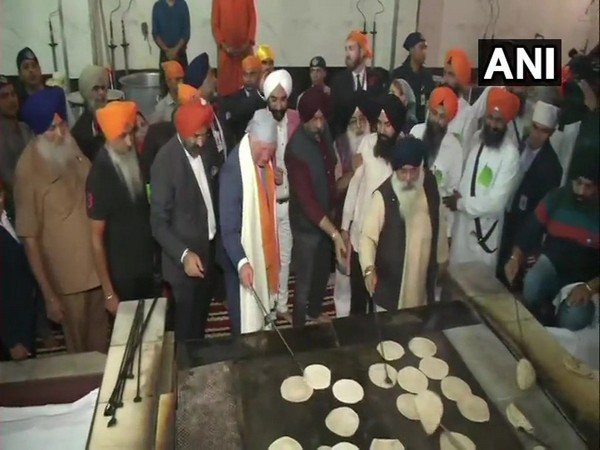 Prince Charles was seen flipping roties at Gurudwara Bangla Sahib during his three day visit to India on Wednesday in New Delhi. Photo/ANI