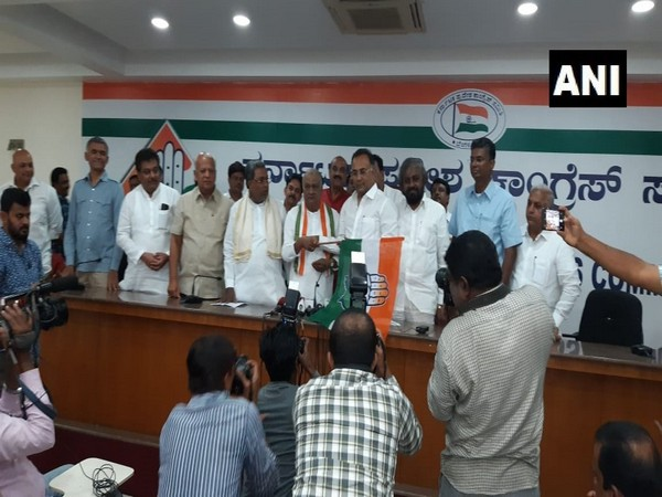 Former BJP MLA Raju Kage (holding Congress party flag) joining Congress in Bengaluru on Thursday.