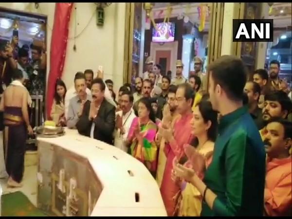 Uddhav Thackeray along with family offering prayers at Siddhivinayak Temple in Mumbai on Thursday. Photo/ANI