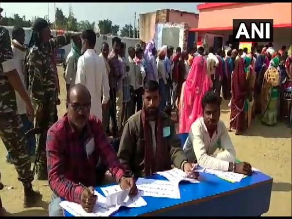 People stood in queues outside polling booths to exercise franchise in Naxal affected area of Kanhachatti in Chatra district (Photo/ANI)