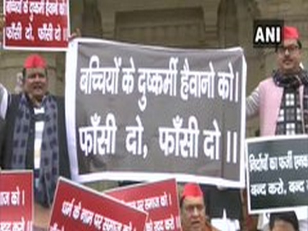 Visuals of SP leaders holding a protest in front of Lucknow Assembly on Tuesday. Photo/ANI