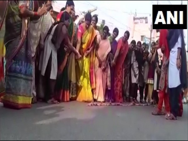Women bursting fire-crackers to celebrate encounter killing of four rape accused in Krishna, Andhra Pradesh, on Friday.