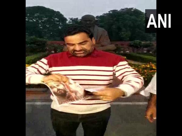 Lok Sabha MP Hanuman Beniwal tearing the posters of the film 'Panipat' at the Parliament on Tuesday.