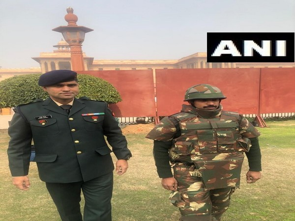 Major Anoop Mishra of the Indian Army with an Army jawan with full body protection bulletproof jacket which Mishra developed. Photo/ANI