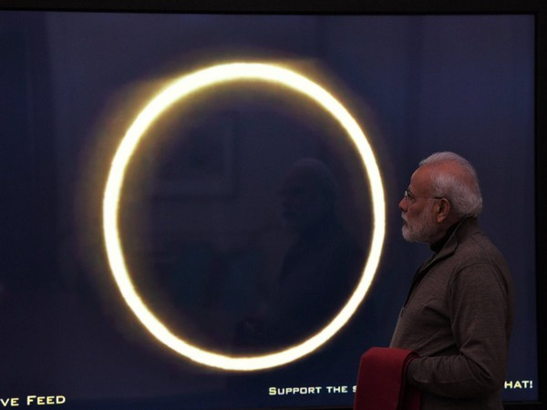 Prime Minister Narendra Modi watching the live stream of the eclipse