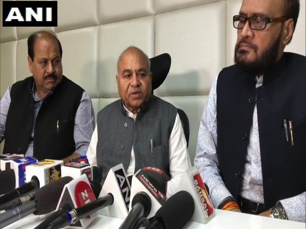 Madhya Pradesh Minister Govind Singh (middle) addressing a press conference in Bhopal on Monday, (Photo/ANI)