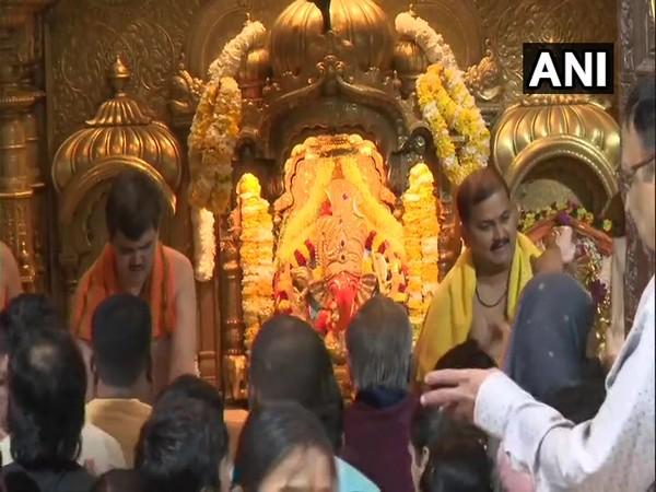 Devotees at Shree Siddhivinayak Ganapati Temple in Mumbai on Wednesday.
