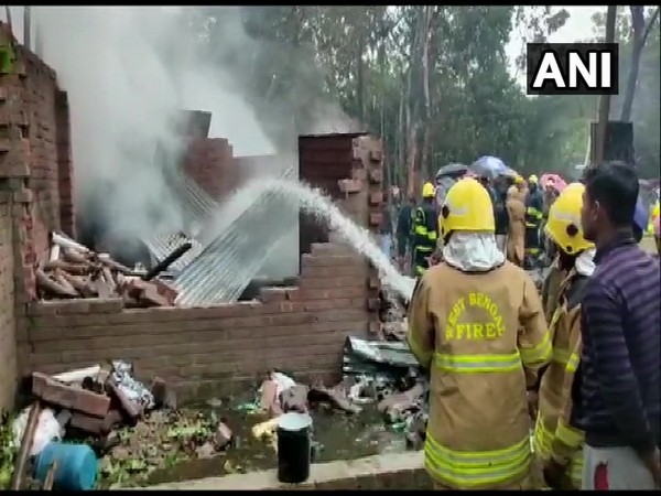 Firemen dousing the fire at a cracker factory in West Bengal's North 24 Parganas district on Friday.