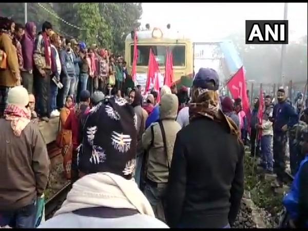 Protesters block railway track in Kanchrapara,North 24 Parganas on Wednesday. (Photo/ANI)