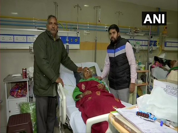 The 110-year-old woman along with her son at PGIMER, Chandigarh on Tuesday. Photo/ANI
