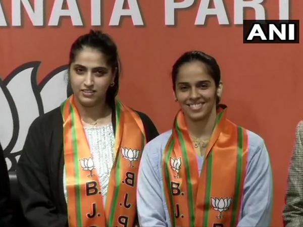 Ace Indian shuttler Saina Nehwal along with her elder sister Abu Chandranshu Nehwal while joining BJP on Wednesday. (Photo/ANI)